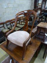 A Victorian mahogany open frame nursing chair