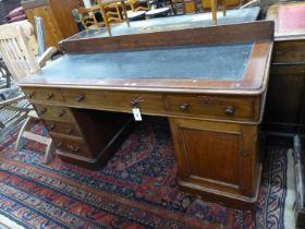 A late Victorian mahogany pedestal desk, length 152cm