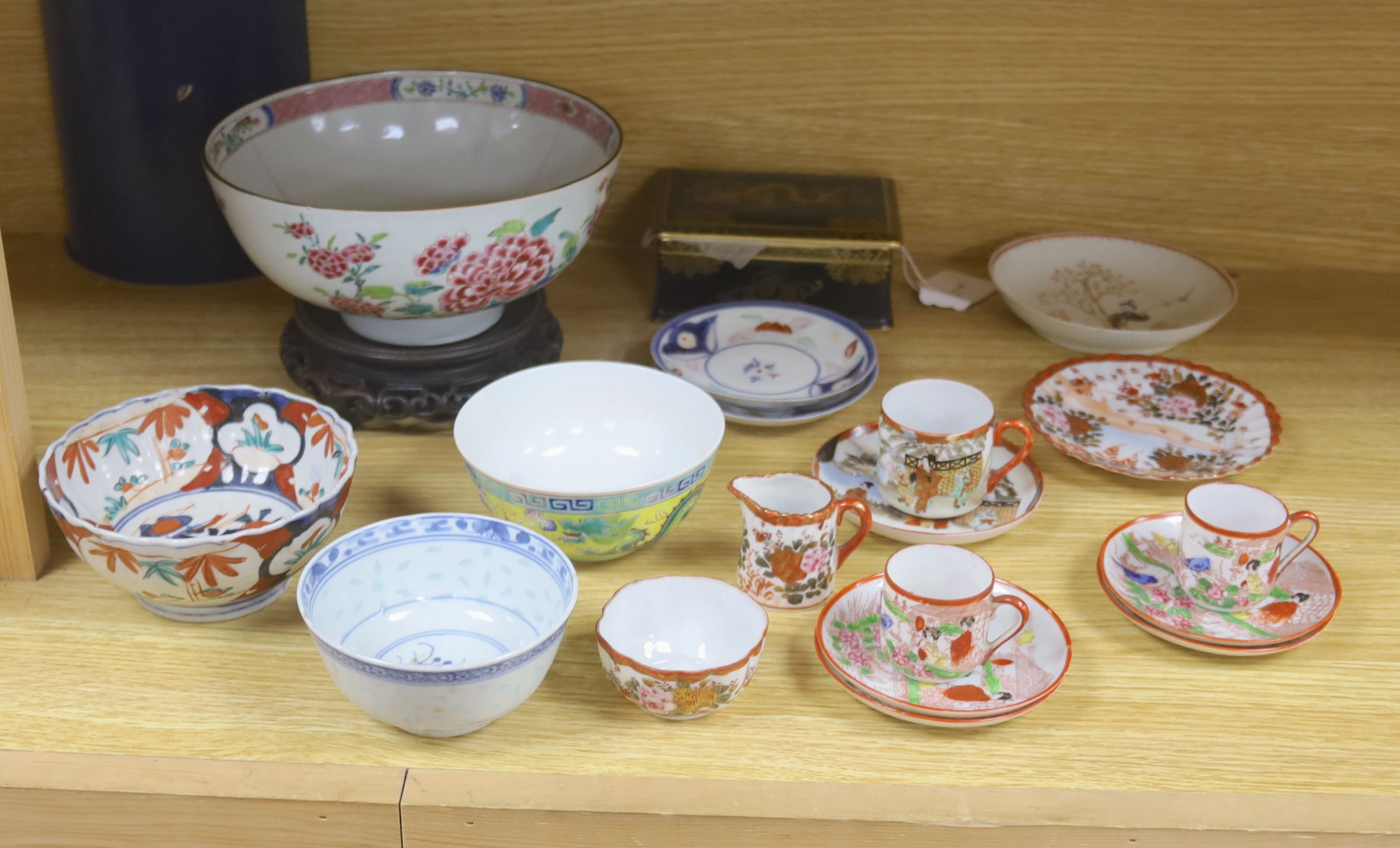 A collection of Chinese and Japanese ceramics,including a famille rose Export bowl on hardwood