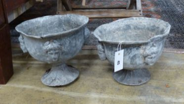 A pair of early 20th century lead garden urns, diameter 26cm, height 23cm