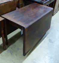 A George III mahogany drop leaf dining table, length 104cm