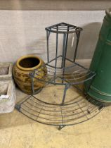 A wrought iron three tier plant stand, height 75cm and a tin glazed vase,