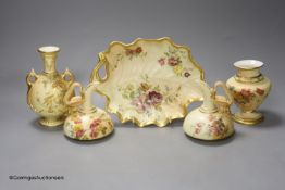 A Royal Worcester blush leaf dish, a pair of ewers, a two handled vase and another