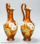 A pair of Royal Doulton stoneware ewers, height 30cm