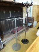 Two contemporary metal coat stands, larger 180cm high