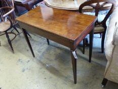 A George III rectangular mahogany folding card table, height 73cm, width 92cm, depth 45cm