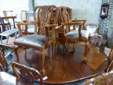 A set of twelve Chippendale style mahogany dining chairs, four with arms