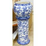 A Wedgwood Etruria England Swallow blue and white jardiniere and stand, height 79cm