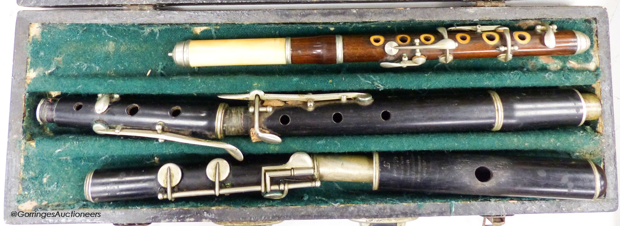 An incomplete Jerome Thibonville Lamey clarinet and an ivory and wood flute
