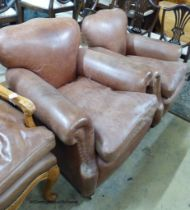 A pair of 1940's French tan leather club armchairs, width 90cm, depth 88cm, height 82cm