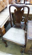 A set of four George I walnut dining chairs on front cabriole legs