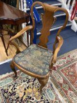 A Queen Anne revival walnut elbow chair