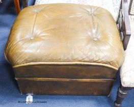 A tan leather footstool. W-58, H-36cm.