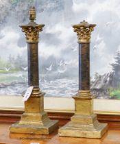 A pair of faux ormolu corinthian column table lamps, height 43cm