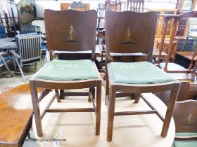 A set of four 1920's chinoiserie lacquer dining chairs
