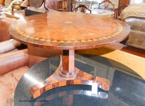 A 19th century circular parquetry low table (cut down), diameter 74cm, height 45cm