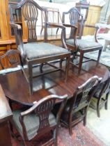 A set of eight Hepplewhite style mahogany dining chairs. (two having arms)