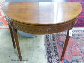 A George III style mahogany demi-lune card table. W-92, D-46, H-77cm.