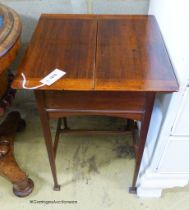 An Edwardian mahogany work table, with twin hinged flap top, W.44cm D.44cm H.69cm