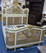 A Louis XVI style painted, giltwood and caned double bed frame, width 160cm, length 212cm, height