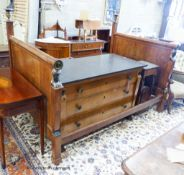 A 19th century French mahogany Egyptian taste three piece bedroom suite, comprising a three quarter