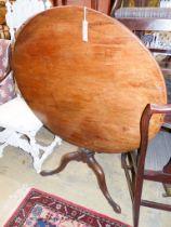 A George III circular mahogany tilt top tea table, Diam.85cm H.71cm