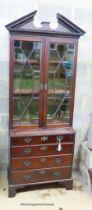 A George III style mahogany bookcase/gun cabinet, W.78cm D.41cm H.212cm