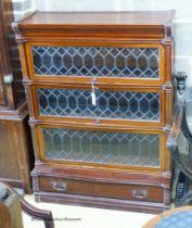 A Globe Wernicke serpentine mahogany four section bookcase. W.90cm D.33cm H.120cm.