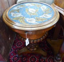 A Victorian walnut work table with circular hinged beadwork top. D-56, H-75cm.