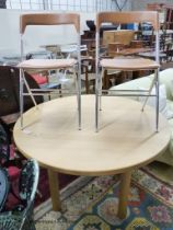 A circular beech breakfast table, depth 122cm, and two Italian chrome chairs.