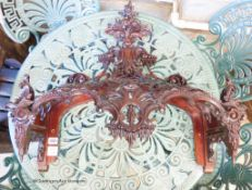 A carved mahogany bed canopy in the style of Thomas Chippendale, W.61cm H.63cm