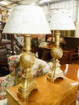 A pair of Italian style gilt table lamps and shades, H.85cm