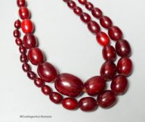 A double strand simulated oval cherry amber bead choker necklace (string broken), 44cm, gross