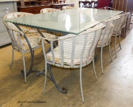 A rectangular glass topped wrought iron garden table and eight chairs. Table, 200x100x75cm.