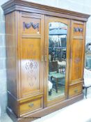 A late Victorian walnut triple mirrored wardrobe, W.180cm D.58cm H.209cm