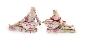 A pair of 19th century Meissen figural sweetmeat dishes