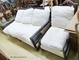 An early 20th century carved mahogany bergere settee, W.186cm D.94cm H.85cm, together with a