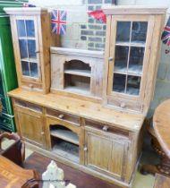 A stripped pine dresser, W.185cm D.66cm H.202cm