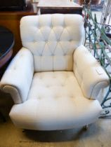 A Laura Ashley armchair upholstered in buttoned natural fabric, width 82cm, depth 90cm, height 86cm