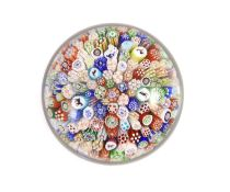 A Baccarat close packed millefiori glass paperweight, dated 1848,with pictorial silhouette canes