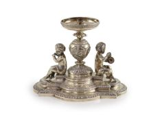 A Victorian silver centrepiece (lacking trumpet),with engraved and embossed foliate decoration and