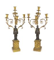 A pair of 19th-century French bronze and ormolu candelabrawith scrolling branches and classical