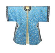 A Chinese blue silk 'butterfly' Winter robe, late 19th century,embroidered with butterflies on a