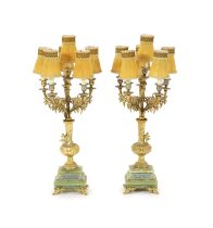 A pair of elaborate gilt metal and green onyx six-light candelabra table lamps on pedestal urn