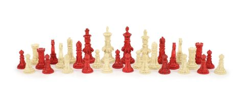 A 19th century Anglo-Indian white and stained bone chess set, with unusual carved palmate