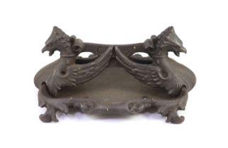 A Coalbrookdale cast iron 'griffin' boot scraperH 19cm. W 44cm. D 37cm.