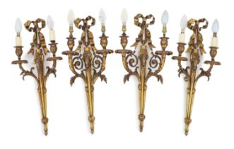 Two pairs of Adam Revival ram's mask head motif wall lightswith ribbon tied crests and acanthus