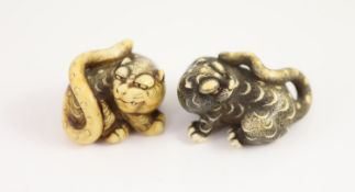 Two Japanese ivory netsuke of a tiger, Edo period, first half 19th century,each with horn inlaid