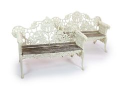 After Coalbrookdale, a pair of cast iron 'Oak and ivy' bencheswith white paintwork and teak slatted