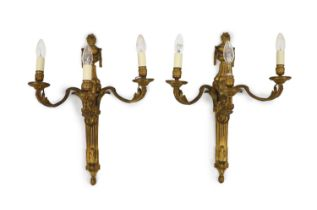 A pair of Louis XVI style ormolu three branch wall lightswith urn crested lion's mask stems and